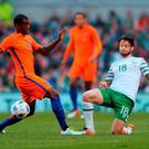 Republic of Ireland's Harry Arter (R) in action against Netherlands' midfielder Georginio Wijnaldum during the friendly football match between Ireland and the Netherlands at the Aviva Stadium