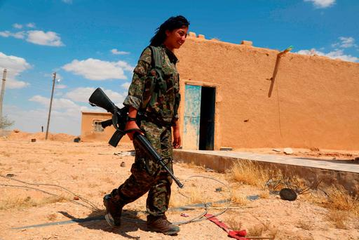 A fighter from the YPG in the northern Syrian province of Raqa Photo: DELIL SOULEIMAN / AFP / Getty Images