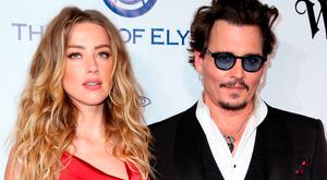 In this Jan. 9, 2016 file photo, Amber Heard, left, and Johnny Depp arrive at The Art of Elysium's Ninth annual Heaven Gala at 3LABS, in Culver City