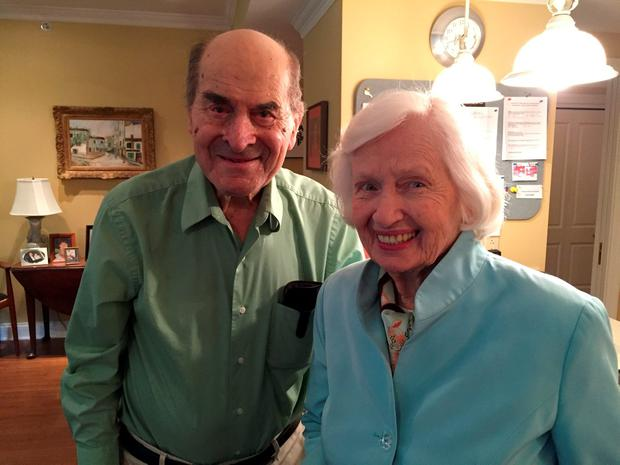 Dr. Henry Heimlich (L), the 96-year-old Cincinnati surgeon credited with inventing the life-saving technique named for him, poses with Patty Ris, 87, who he saved this week from choking on a hamburger, at the Deupree House seniors' home in Cincinatti, Ohio