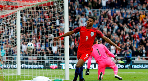 Marcus Rashford celebrates after scoring the first goal for England. Action Images via Reuters / Ed Sykes.