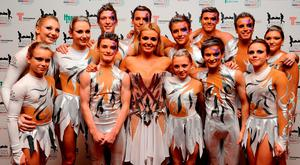 Katherine Jenkins with gymnastic troupe Spellbound backstage at the Help For Heroes Concert at Twickenham Stadium, who won series four of Britain's Got Talent. Photo: Ian West/PA Wire