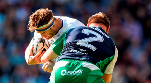 Jamie Heaslip is tackled by Tom McCartney during yesterday's Pro 12 final in Edinburgh. Photo: Ramsey Cardyfacet