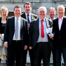 Future: Alan Kelly, pictured third from left, with members of the Labour party outside Leinster House Photo: Tom Burke