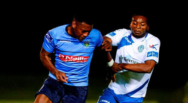 UCD's Maxi Kouogun (L) in action against Finn Harps' Wilfried Tagbo. Photo: Sportsfile