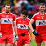 Derry players Ryan Bell, Gareth McKinless and Niall Holly leave the field at half-time during last Sunday's defeat to Tyrone. Photo: Oliver McVeigh