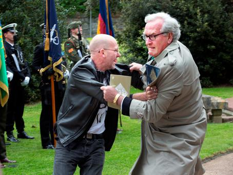 Security lapse: A protester is tackled by the Canadian Ambassador to Ireland, Kevin Vickers, at the State event marking the deaths of British Soldiers in the Easter Rising at Grangegorman cemetery Photo: Tony Gavin