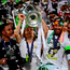 Real Madrid's Croatian midfielder Luka Modric (C) lifts the trophy after Real Madrid won the UEFA Champions League final football match between Real Madrid and Atletico Madrid at San Siro Stadium. /Getty Images