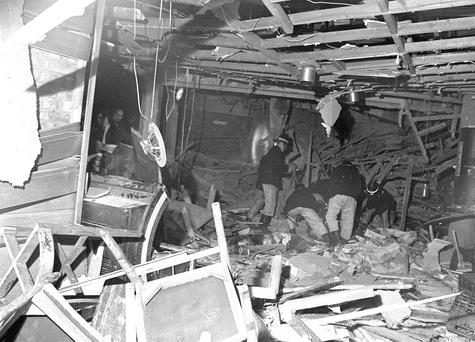 Firemen searching through debris in Birmingham in the aftermath of the bombings Photo: PA Wire