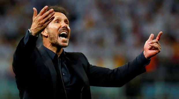 Atletico Madrid coach Diego Simeone reacts during the penalty shootout Reuters / Kai Pfaffenbach