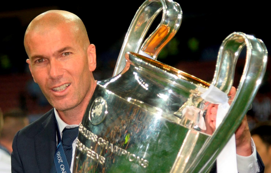 Real Madrid's French coach Zinedine Zidane poses with the trophy after Real Madrid won the UEFA Champions League final. Getty Images