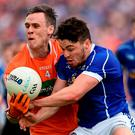 Mark Shields of Armagh in action against Conor Moynagh of Cavan in the Ulster GAA Football Senior Championship quarter-final between Cavan and Armagh at Kingspan Breffni Park, Cavan. Photo by Oliver McVeigh/Sportsfile