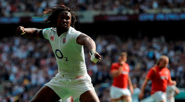 England's Marland Yarde celebrates after he goes over to score a try during the Old Mutual Wealth Cup match at Twickenham