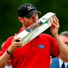 England's Chris Wood celebrates with trophy after winning the BMW PGA Championship at Wentworth