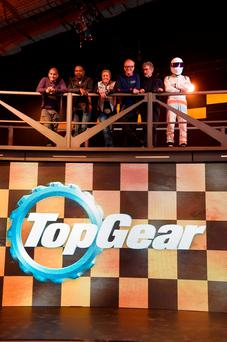 Top Gear presenters (left to right) Chris Harris, Rory Reid, Sabine Schmitz, Chris Evans, Eddie Jordan and The Stig. Photo: Andrew Matthews/PA Wire