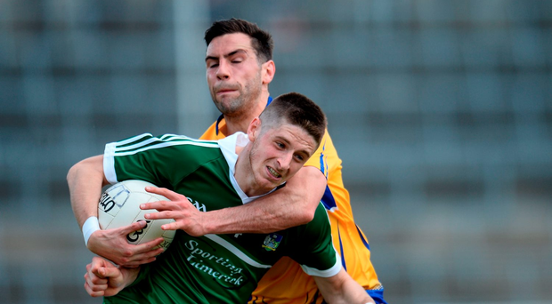 Limerick's Stephen Cahill tries to break the tackle of Clare's Dean Ryan at the Gaelic Grounds. Photo: Sportsfile