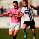 Dundalk's Dane Massey battles for the ball with Eric Molloy of Wexford Youths at Oriel Park, Dundalk. Photo: Paul Mohan/Sportsfile