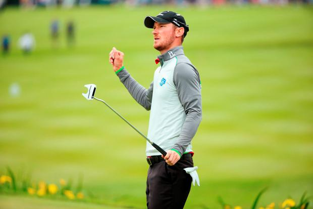England's Chris Wood celebrates victory on the 18th green yesterday of the BMW PGA Championship at Wentworth, Virginia Water, England. Pic: Getty Images