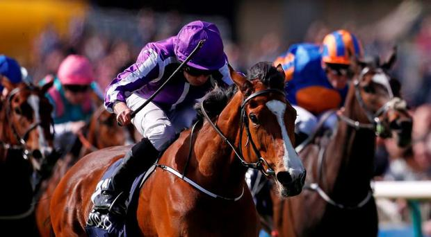 Minding and Ryan Moore, here getting the better of Ballydoyle in the English 1,000 Guineas, is on track for Epsom. Photo: Getty