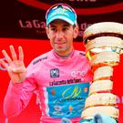 Vincenzo Nibali collects the Giro d'Italia trophy in Turin yesterday. Photo: Getty