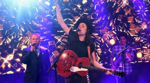 Wayne Rooney performing 'Hold Back the River' with the singer, James Bay CREDIT: GETTY