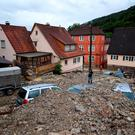 Cars are covered in rubble on a street in Braunsbach, southwestern Germany (Marijan Murat/dpa via AP)
