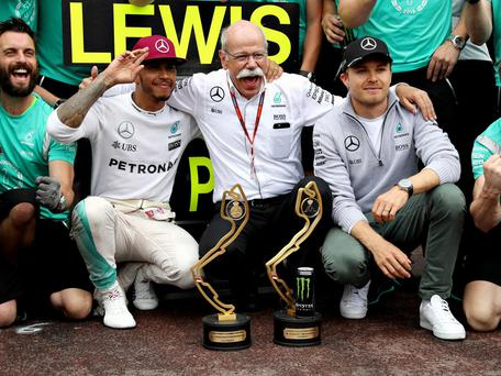 Lewis Hamilton celebrates his Monaco Grand Prix victory with Head of Mercedes-Benz Cars Dieter Zetsche and Nico Rosberg. Getty