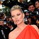 "Kate Moss poses as she arrives on May 16, 2016 for the screening of the film ""Loving"" at the 69th Cannes Film Festival"