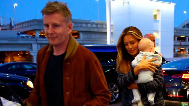 Cat Deeley and husband Patrick Kielty seen arriving at LAX with their son to catch a flight. Picture: Pap Nation / Splash News