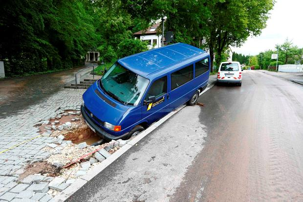 A damaged car is pictured after floods in the town of Schwaebisch Gmuend near Stuttgart, Germany, May 30, 2016. REUTERS/Michaela Rehle
