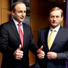 Fianna Fáil leader Micheál Martin (left) with Taoiseach and Fine Gael leader Enda Kenny. Photo: Steve Humphreys