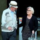 Audrey Mahon leaves court with Dave Mahon's father. Photo: Gerry Mooney