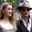 Johnny Depp and Amber Heard and inset, Amber claims she received the bruise on her face when Johnny threw an iPhone at her