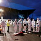 French forensic experts take part in a mock attack drill outside the Grand Stade stadium (aka Parc Olympique Lyonnais or the Stade des Lumieres) in Decines, near Lyon, France, in preparation of security measures for the UEFA 2016 European Championship May 30, 2016. REUTERS/Robert Pratta