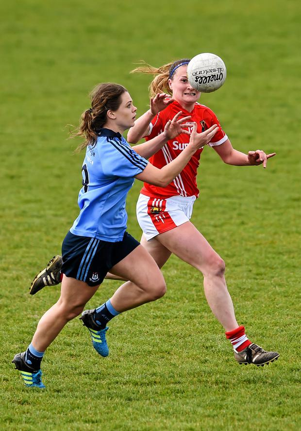Noelle Healy, Dublin, in action against Annie Walsh, Cork. Lidl Ladies Football National League, Division 1, semi-final, Cork v Dublin on April 23. St Brendan's Park, Birr, Co. Offaly. Picture credit: Ramsey Cardy / SPORTSFILE