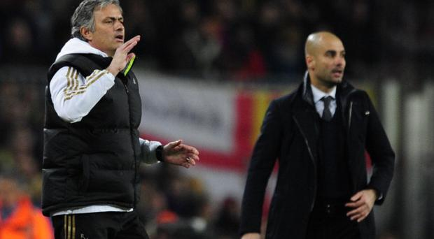"Real Madrid's Portuguese coach Jose Mourinho (L) gestures in front of Barcelona's coach Josep Guardiola (R) after Real Madrid's defender Sergio Ramos received a red card during the second leg of the Spanish Cup quarter-final ""El clasico"" football match Barcelona vs Real Madrid at the Camp Nou stadium in Barcelona on January 25, 2012. AFP PHOTO/JAVIER SORIANO (Photo credit should read JAVIER SORIANO/AFP/Getty Images)"