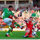 Cyrus Christie of Republic of Ireland has a shot blocked by Mikhail Sivakov