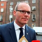 Housing Minister Simon Coveney has been accused of quietly dropping 'the single most progressive measure' taken to help solve the homeless crisis. Photo: Tom Burke