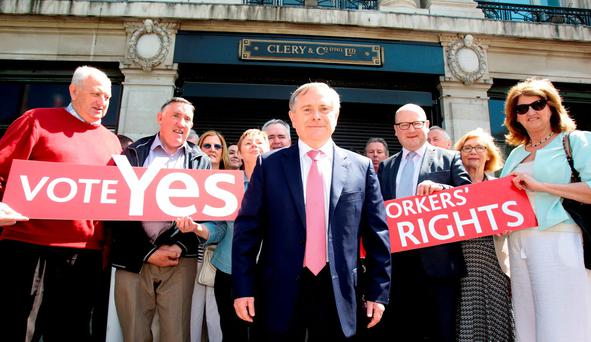 Labour leader Brendan Howlin and party members joined former Clerys staff members outside the store in Dublin yesterday. Photo: Tom Burke