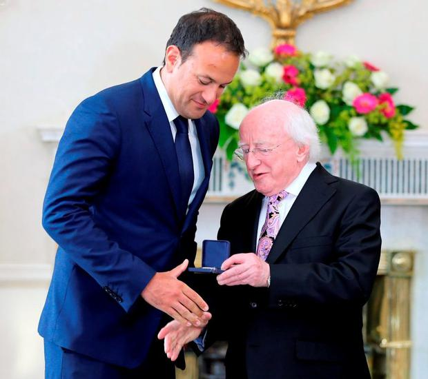 Minister Leo Varadkar with President Michael D Higgins. Photo: Frank McGrath