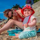 Olivia Martin and her mum Una from Dun Laoghaire soaking up the sun. Picture: Arthur Carron