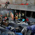 Rescue workers search for survivors after an explosion at a subway construction site in Namyangju, South Korea (Lim Byung-shick/Yonhap via AP) KOREA OUT