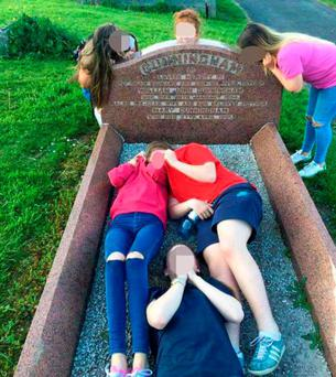 The photographs which were posted on social media of a gang of teenage girls in Belfast City Cemetery