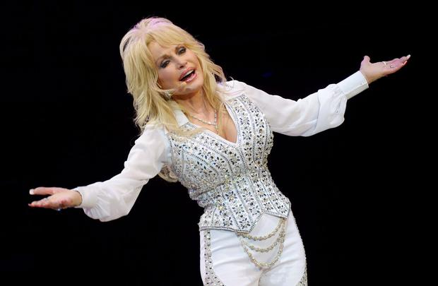 Dolly Parton performs during a concert to benefit Dolly's Imagination Library & Dr. Robert F. Thomas Foundation at The University of Tennessee's Thompson-boling Arena on May 28, 2014 in Knoxville, Tennessee. (Photo by Rick Diamond/Getty Images)