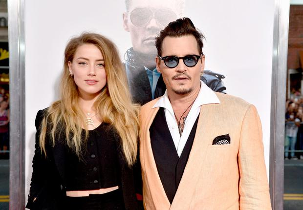 Actors Amber Heard (L) and Johnny Depp attend the