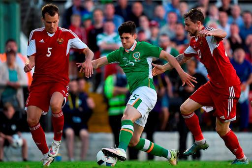 Callum O'Dowda of Republic of Ireland in action against Dzianis Paliakov, left, and Mikhail Sivakov of Belarus during the EURO2016 Warm-up International between Republic of Ireland and Belarus in Turners Cross last night. Photo by Brendan Moran/Sportsfile
