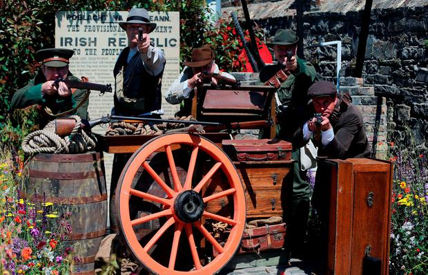 Re-enactors from the Ashbourne re-enactment group in the Bullets and Boiled sweets 1916 garden at the Bloom garden festival in Phoenix park in Dublin. PRESS ASSOCIATION Photo. Picture date: Wednesday June 1, 2016. Photo credit should read: Niall Carson/PA Wire