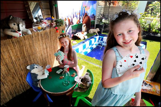 Pictured at Bloom in the Phoenix Park which runs until Monday 6th June was Molly Hayes from Milltown and Rachel Woods from Sandymount both aged 10 playing cards in the Sanctuary Synthetics 'Secret Life of Pets' Garden. Pic Steve Humphreys