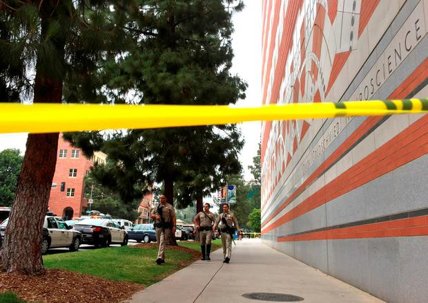 Sheriff deputies work at the scene of a fatal shooting at the University of California, Los Angeles, Wednesday, June 1, 2016, in Los Angeles