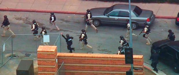 In this image made from video, police respond to a fatal shooting at the University of California, Los Angeles, Wednesday, June 1, 2016, in Los Angeles
